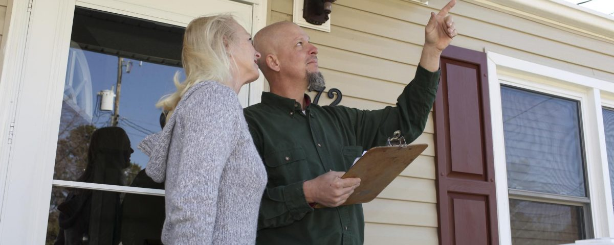 home inspector with home buyer