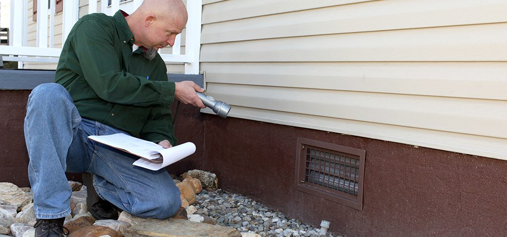 Home inspector checking the foundation.